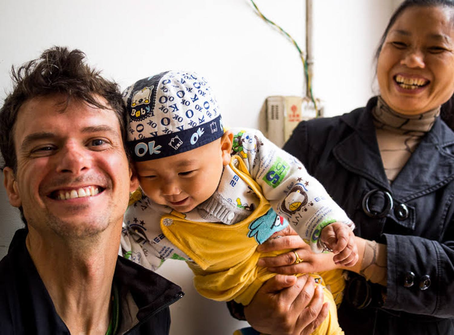 In small villages, people would often bring their babies to meet the strange foreigners.