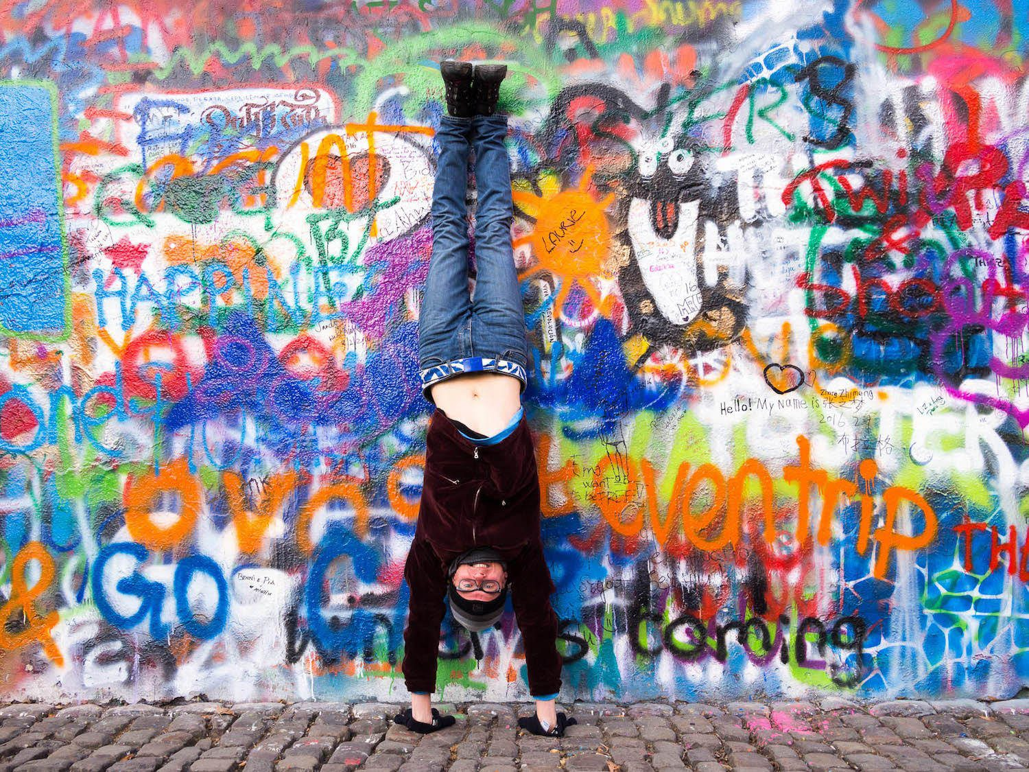 Handstand in front of a famous graffiti wall in Prague.