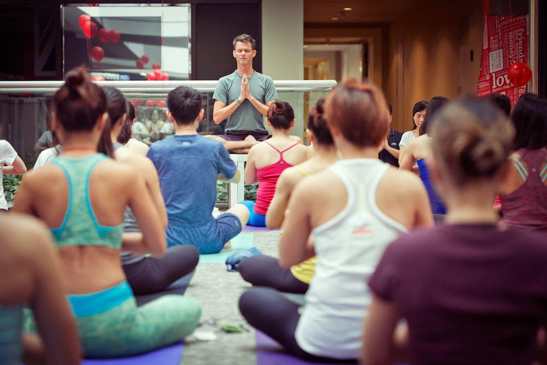 Stephen leading a yoga class in Shanghai.