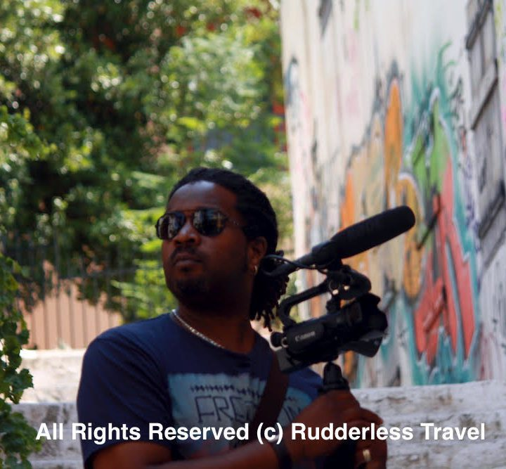 Christopher filming the streets of Athens, Greece for the Rudderless travel vlog.