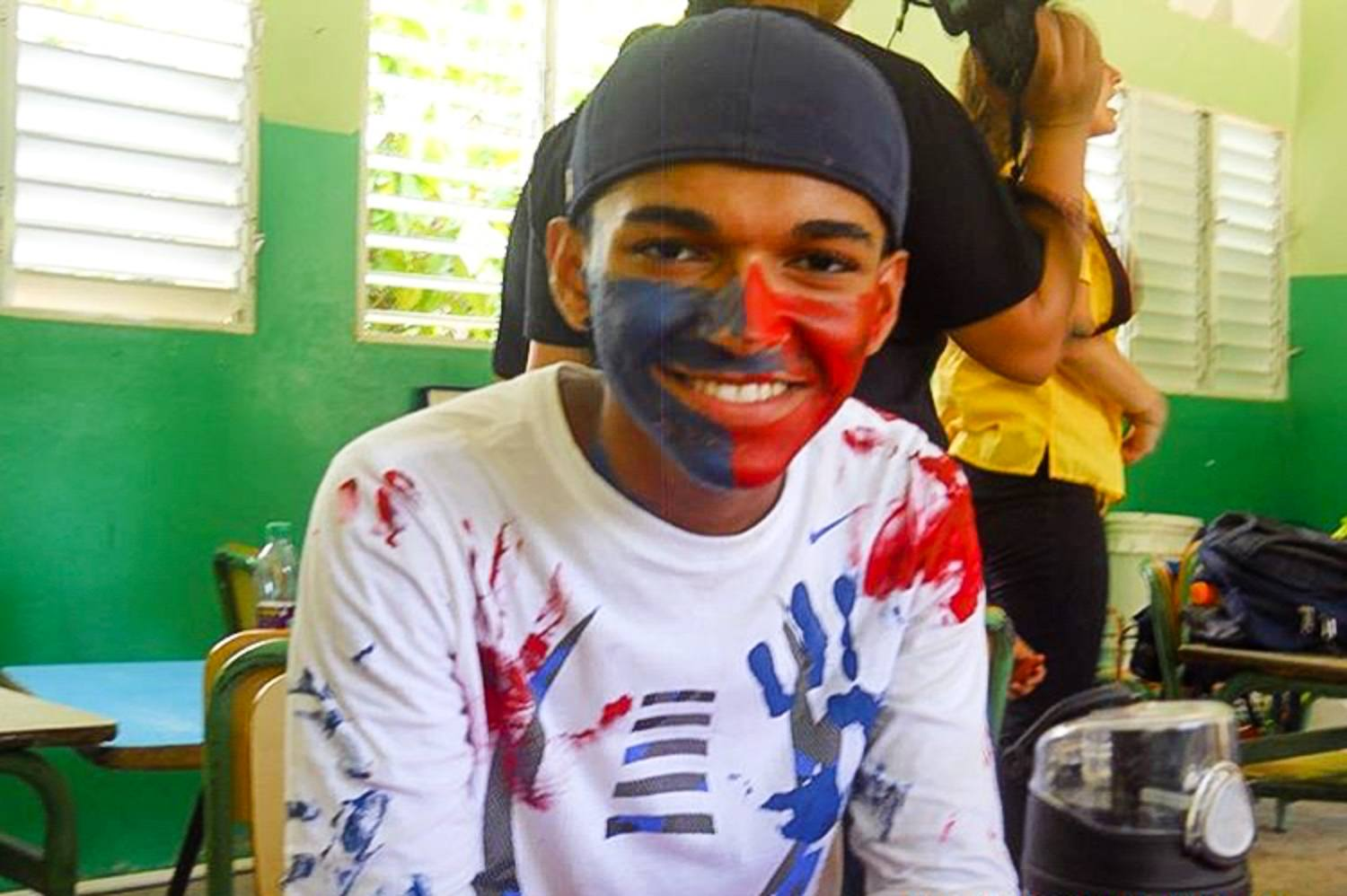 Irvin, covered in paint from the volunteer project!