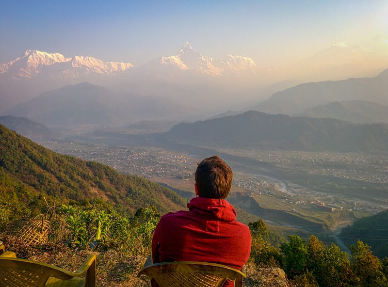 Tim in Nepal, gazing out at the mountains.