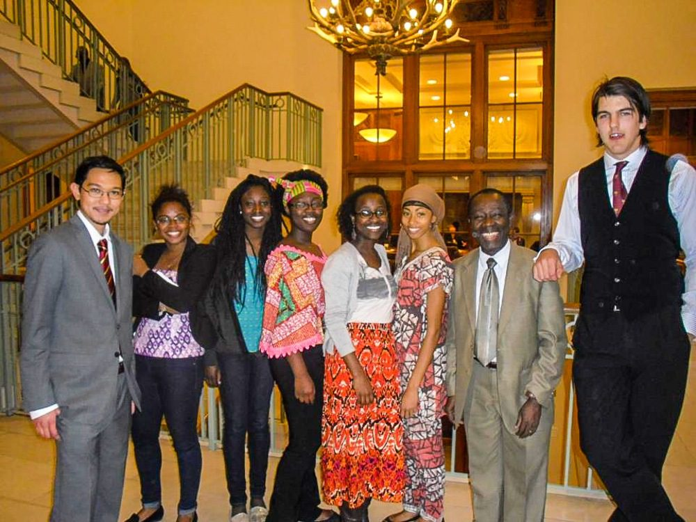 Prince (second from right) with Harvard students.