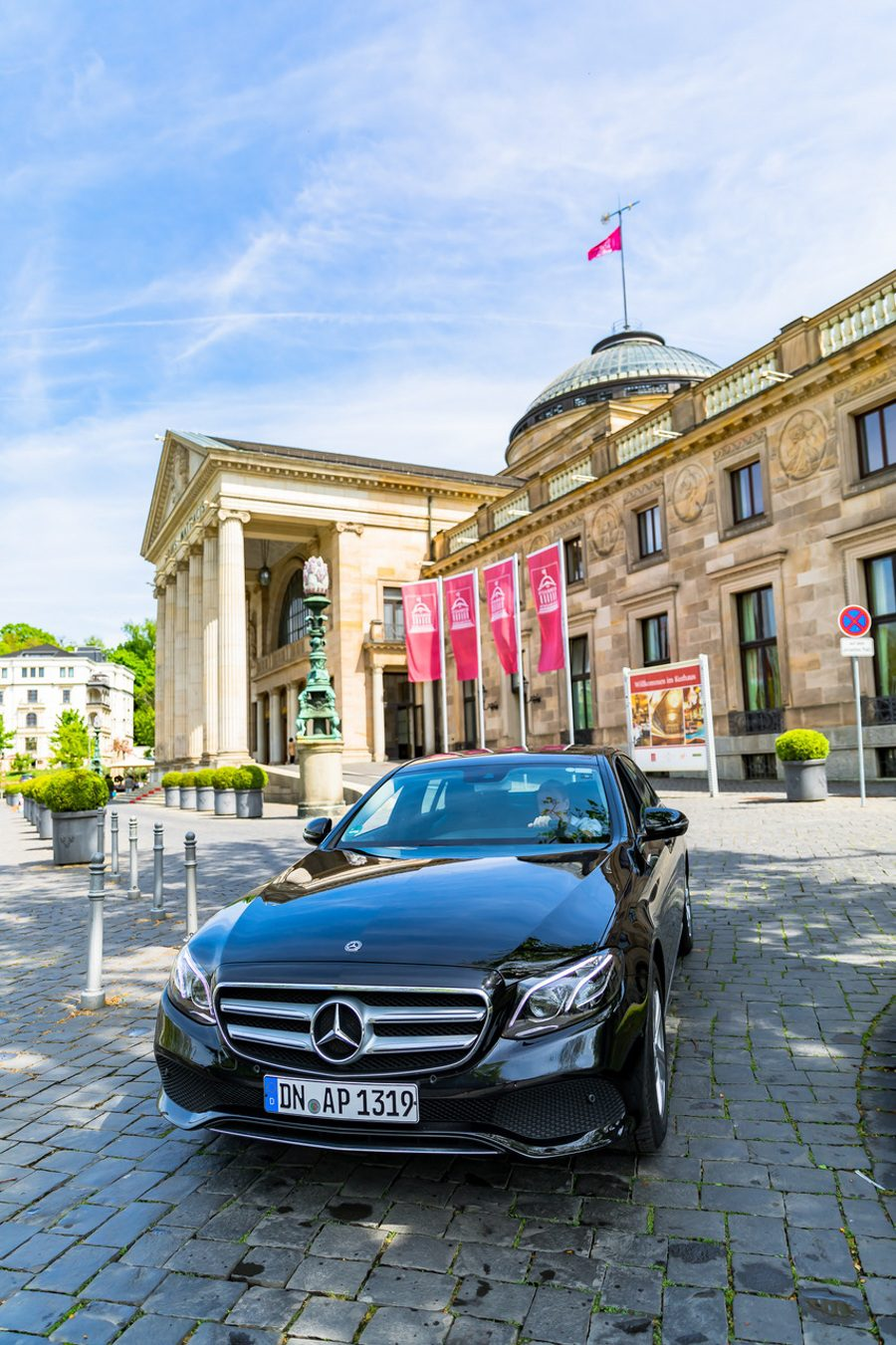 Why taking a road trip can be the best way to learn while traveling, as explained by travel blogger JQ Louise, who roadtripped through Germany's Frankfurt-Rhine-Main region. This European gem is full of food, castles and sight seeing, and JQ learned about Germany like a local. Pictured: The rental car at the Kurhaus in Wiesbaden.