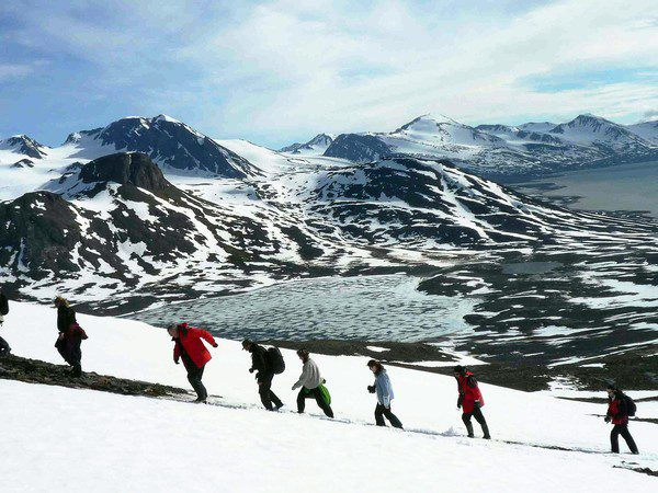 Hiking in the Arctic Spitsbergen Mountains.