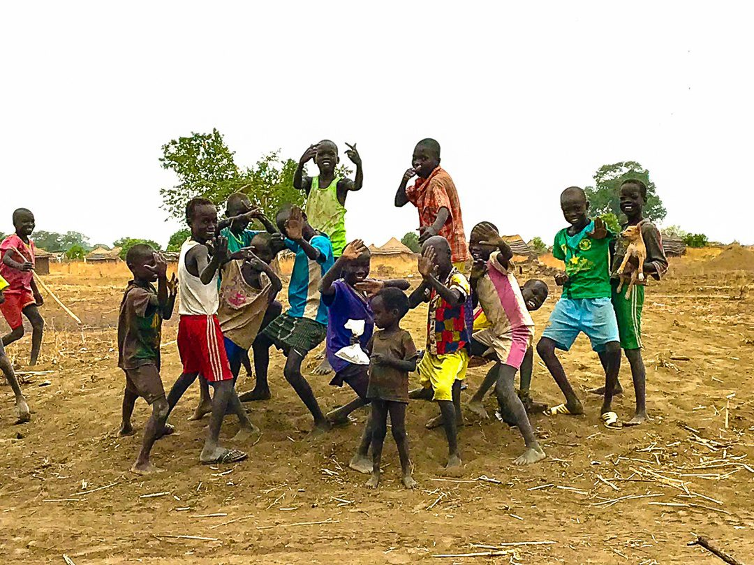 Boys watching the WFSS crew in South Sudan.