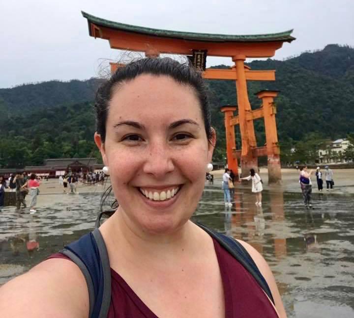Stephanie at the torii gate of Miyajima, Japan: a UNESCO Heritage site.