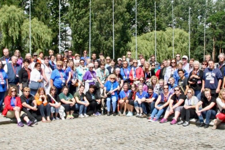 The educational travel group at the memorial area in Auschwitz.