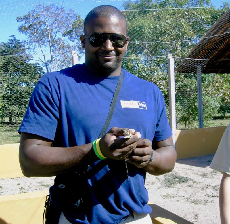 Eugene Roundtree (and a baby caiman) on the Earthwatch Fellowship in Brazil. Photo by Brandon Finegold.