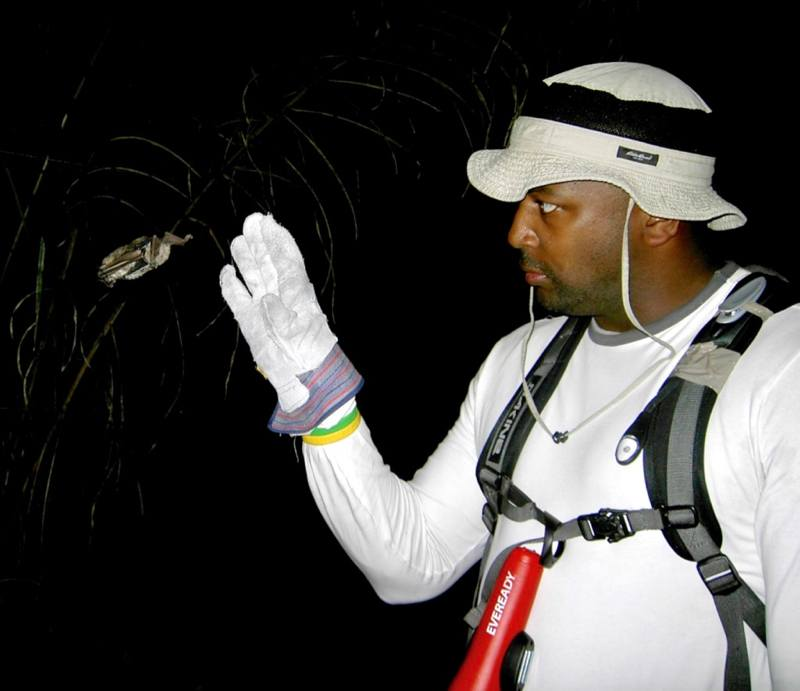Eugene Roundtree (and a bat!) on the Earthwatch Fellowship in Brazil. Photo by Brandon Finegold.