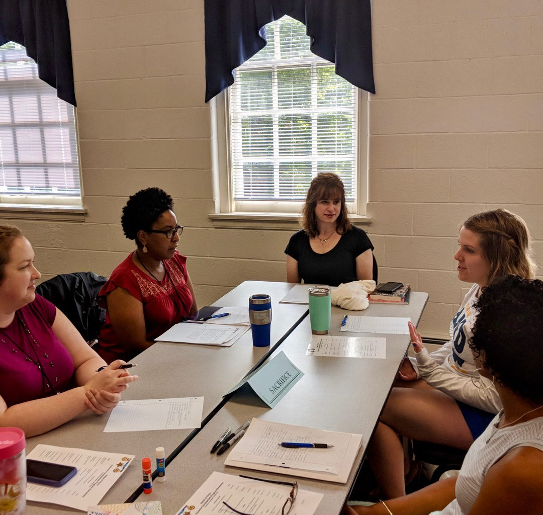 Tara Thomas in discussion with Fellow Educators During Training Session at Freedoms Foundation.