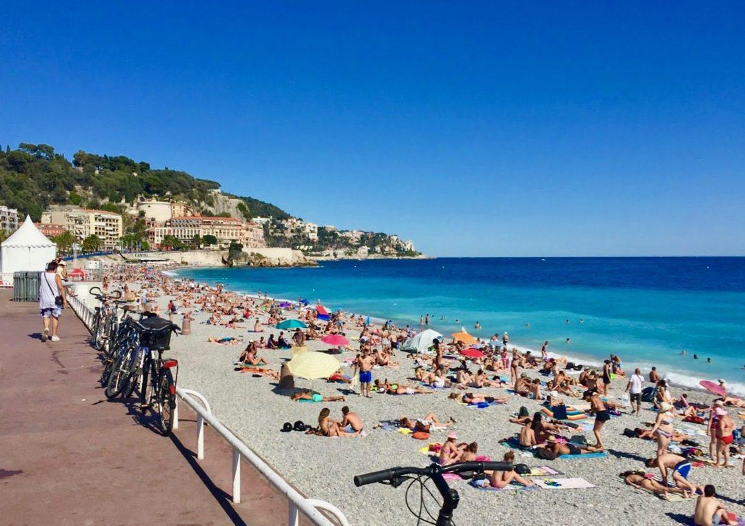 The beach on the Mediterranean Sea near the Promenade des Anglais in Nice, France.