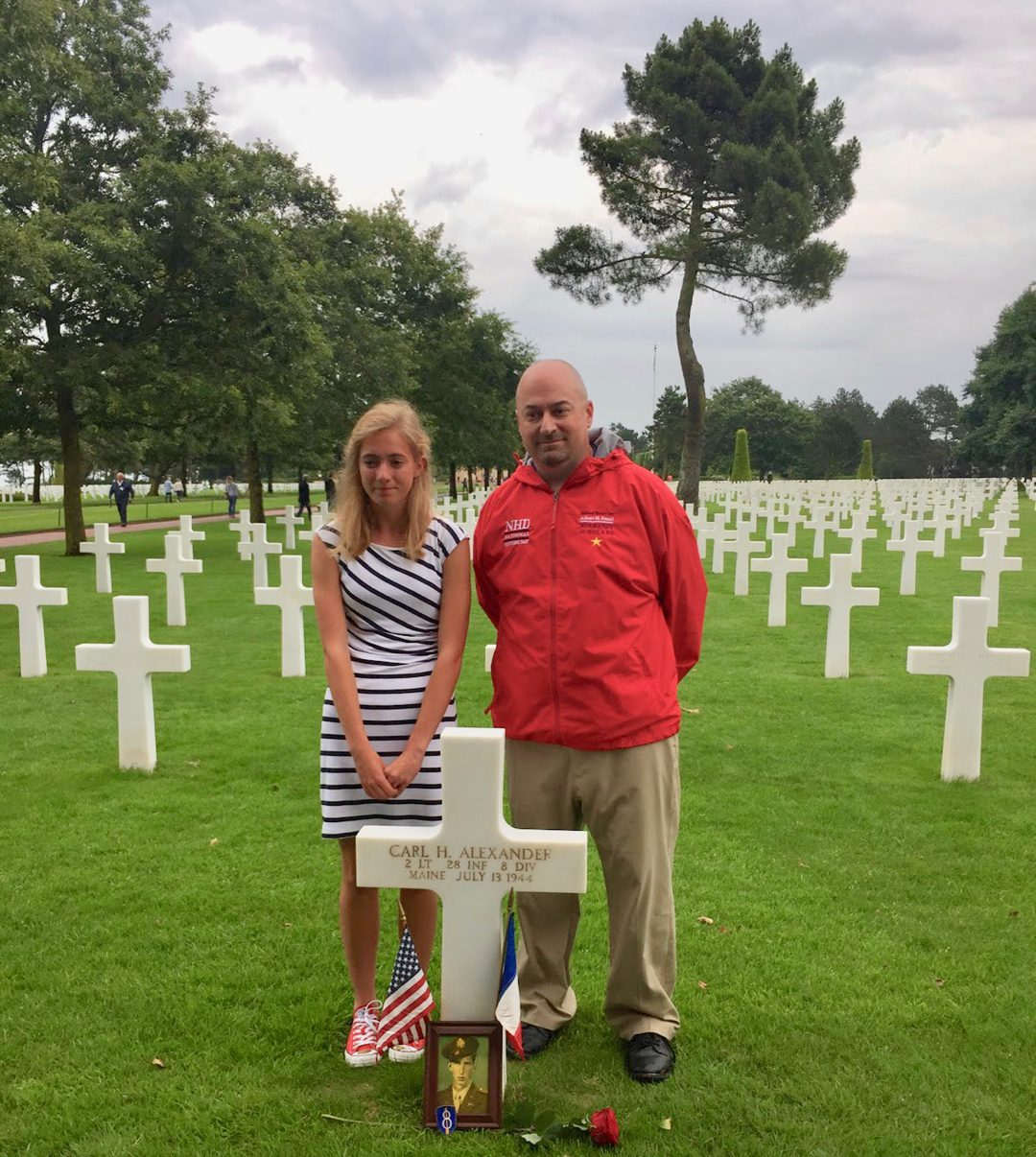Teacher travel grants for History and Social Studies educators: 6 funded global education programs! With a student near the grave of 2nd Lt. Carl H. Alexander of Maine at the Normandy American Cemetery in France.