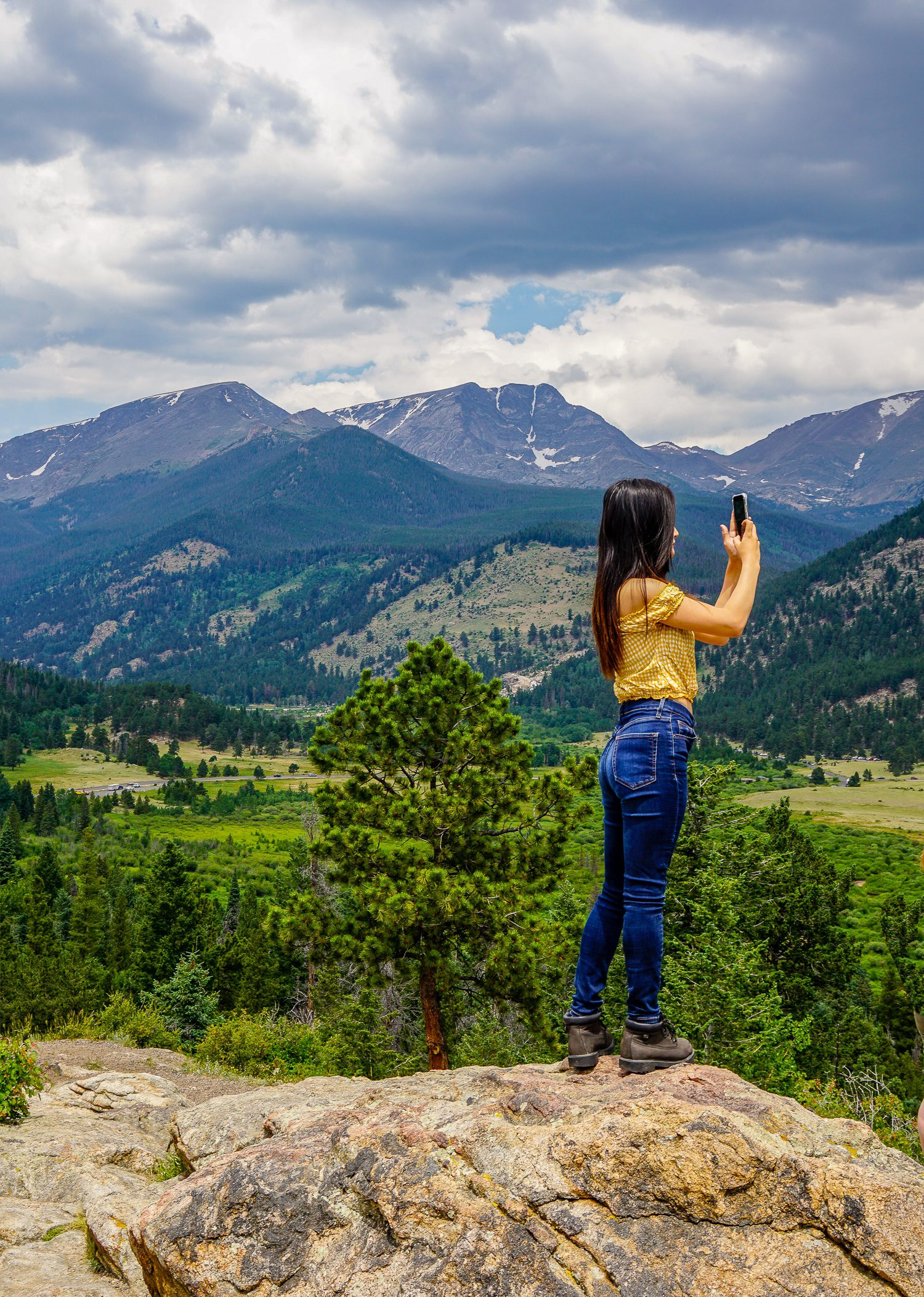 Photo at Rocky Mountain National Park overlook. Is she a traveler or traveller?