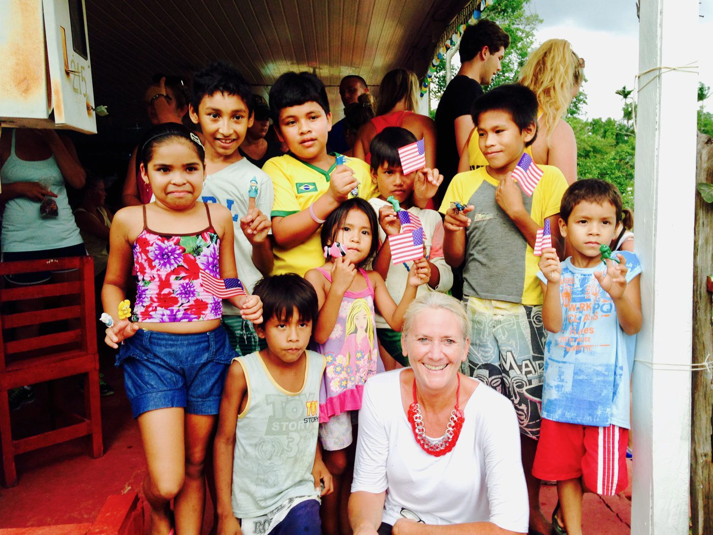 Education author and global travel expert, volunteering by the Amazon river in Brazil.