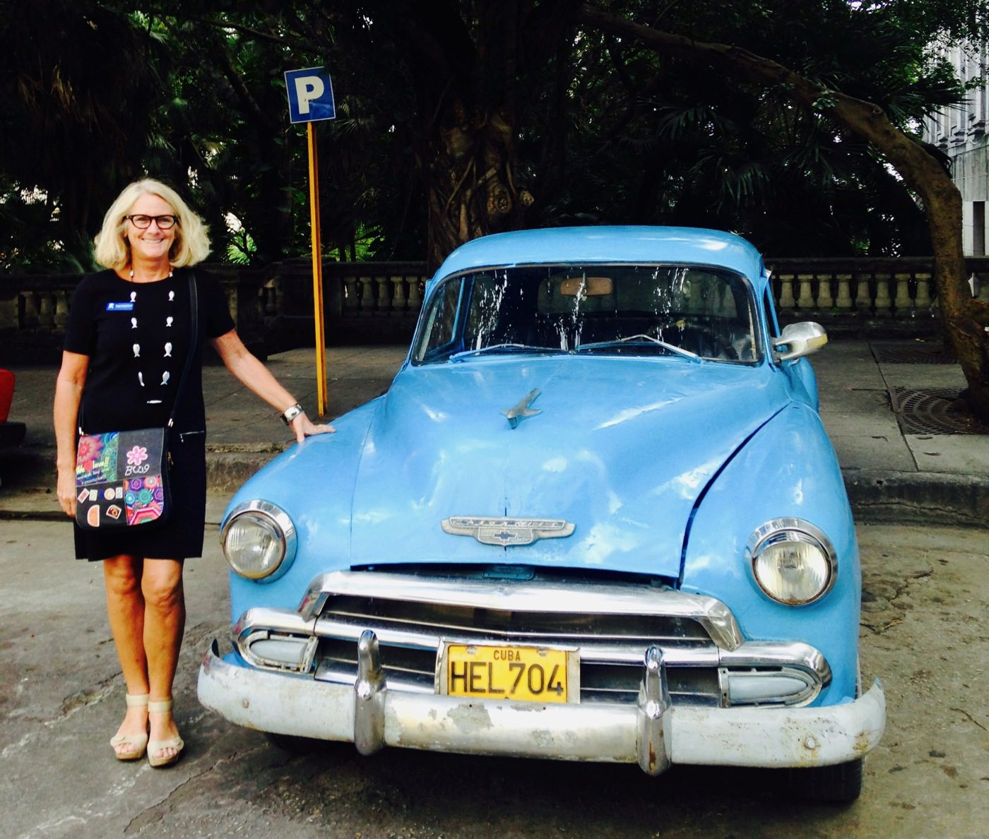 With a vintage car in Havana, Cuba.