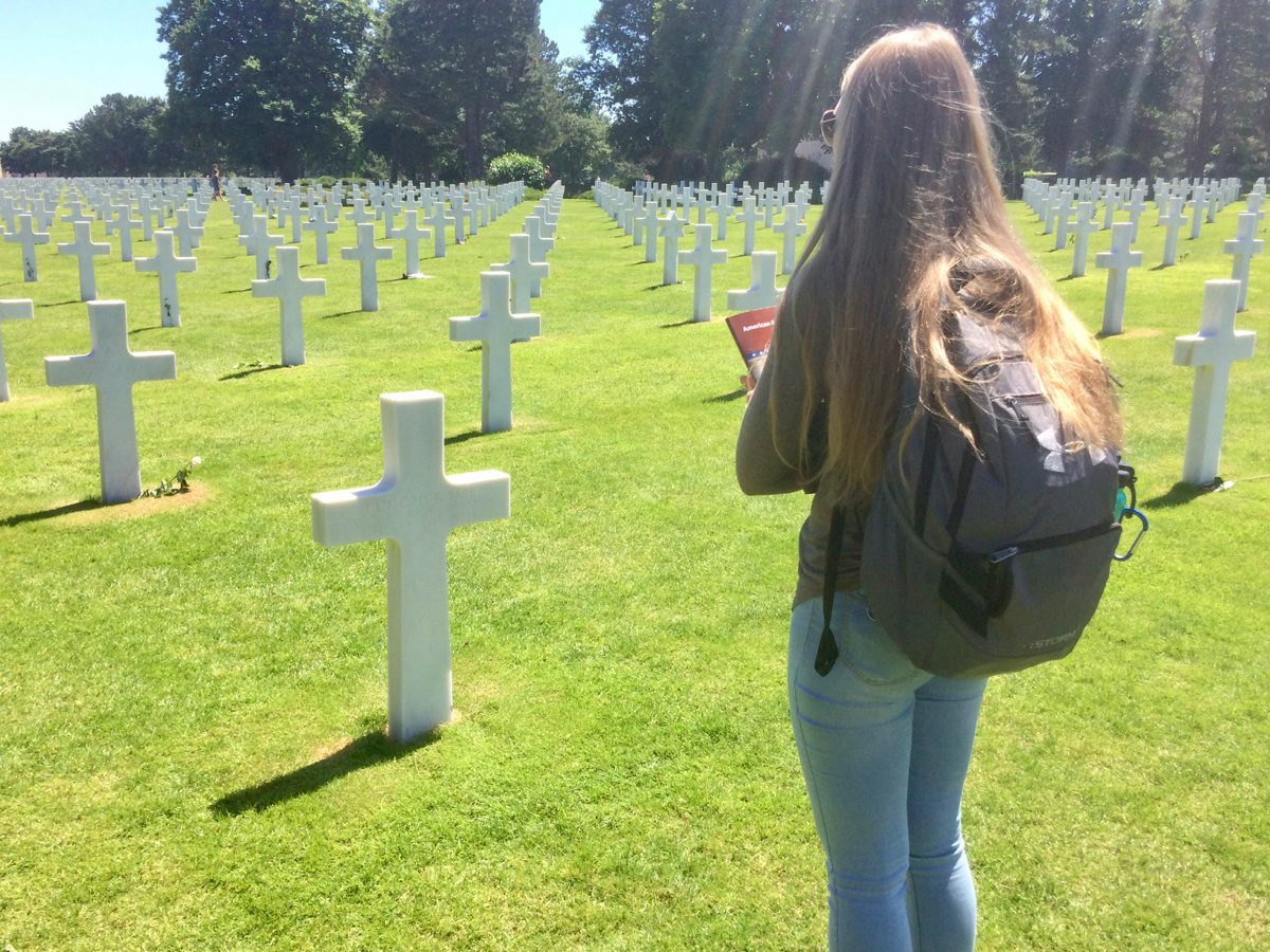 A student found her relative's grave site at the American Cemetery in Normandy, France.