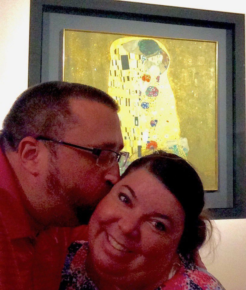 """Todd and wife reenacting """"The Kiss"""" by Gustav Klimt in Vienna."""