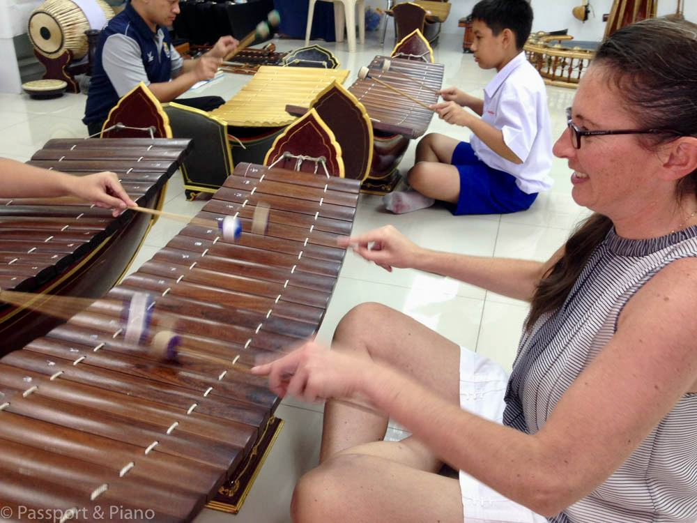 Fiona trying out a traditional Thai instrument.