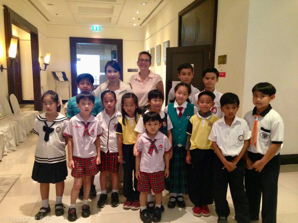 Young piano students in Thailand.